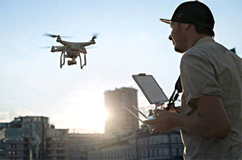 Photo of a man operating a drone